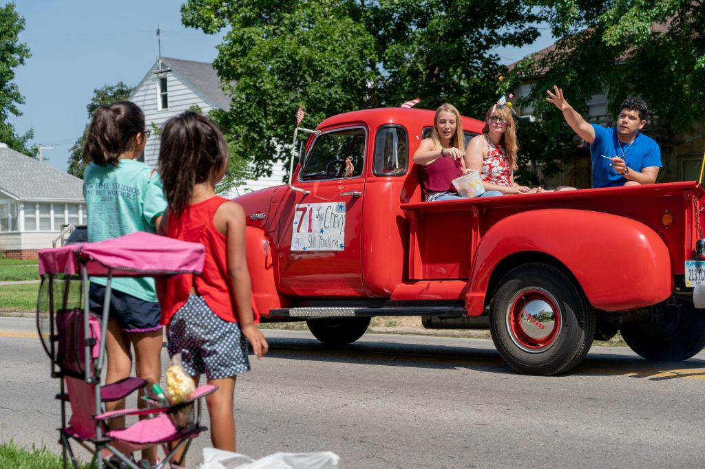A parade consisting of small-business owners, first responders, church groups and citizens marched through Perry, Iowa, for an Independence Day celebration, passing candy out to the kids on both sides of Wills Avenue. (Lenny Martinez Dominguez/News21)