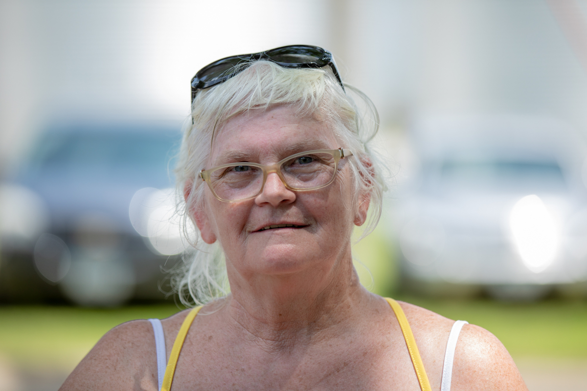 "Debra Allen, who was celebrating Independence Day at Pattee Park in Perry, Iowa, called for more communication between people. ""You've got to think about it and listen to both sides."" (Alex Lancial/News21)"
