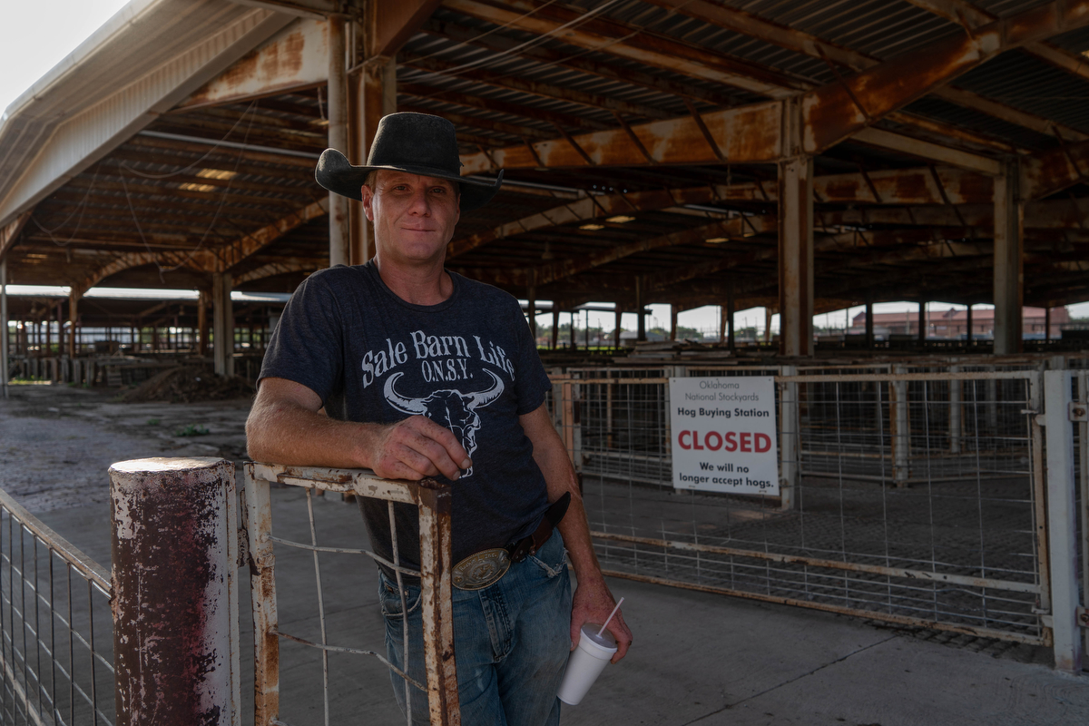 "Cattleman Jay Lewis works at the world's largest stockyards in Oklahoma City. ""My grandpa told me a long time ago, 'Find something you love and you'll never work a day in your life.' I ain't worked yet. I just get paid to play,"" Lewis said. (Tilly Martlatt/News21)"