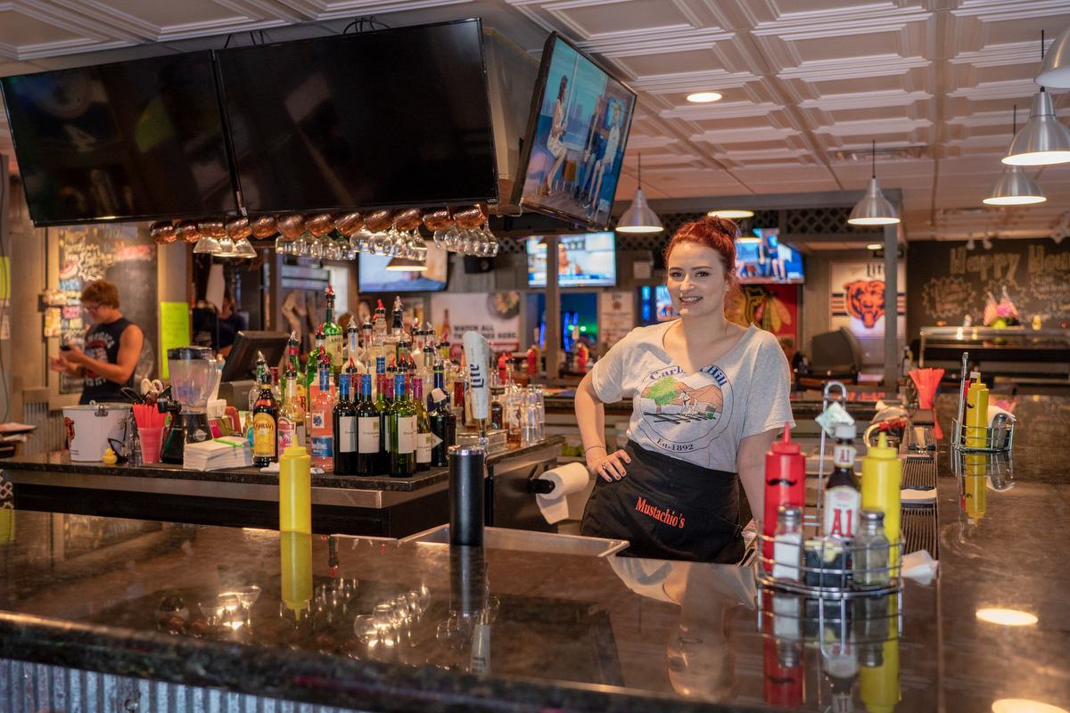 Stephanie Long bartends at Mustachio's in Carbon Hill, Illinois, and hopes America will get better. (Lenny Martinez Dominguez/News21)