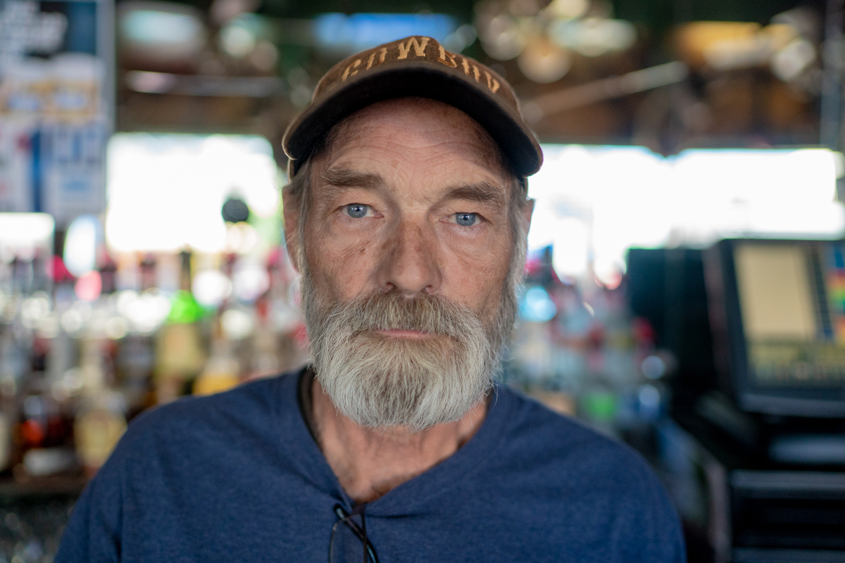 "Buck Ward, one of the managers of the Buckhorn Bar and Parlor in Laramie, Wyoming, has been working at the establishment for 30 years. ""[Trump's] out of touch with America and what Americans want. It's the things he's saying and not saying that is spurring hate."" (Lenny Martinez Dominguez/News21)"