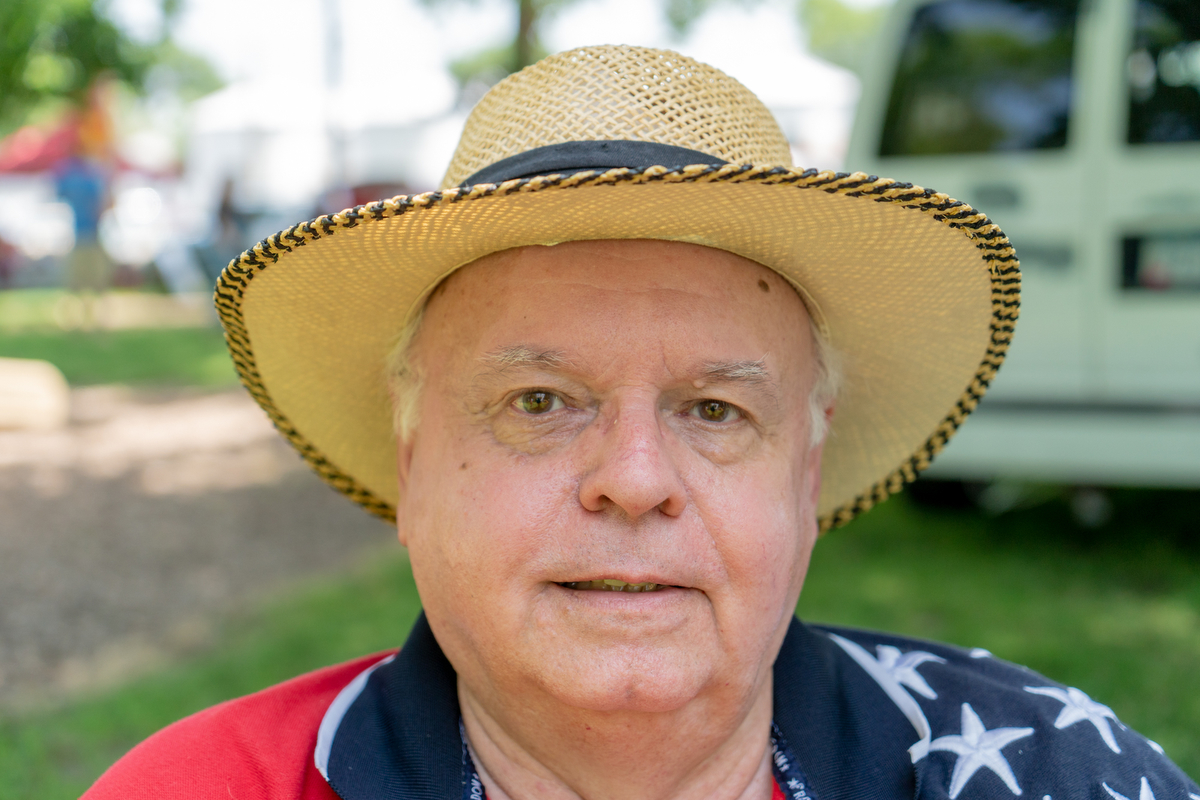 A former broadcast journalist, Jerry Roberts from nearby Jefferson, Iowa, was relaxing at Pattee Park after the parade. (Alex Lancial/News21)
