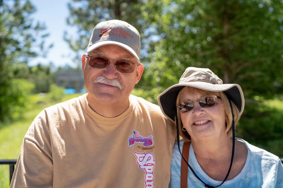 "Jeff(left) and Janet Smith from Michigan said politicians could learn a lot from the presidents featured on Mount Rushmore. ""We have too many ego politicians that are all about themselves and these guys weren't. They were about building America,"" Jeff said. (Lenny Martinez Dominguez/News21)"