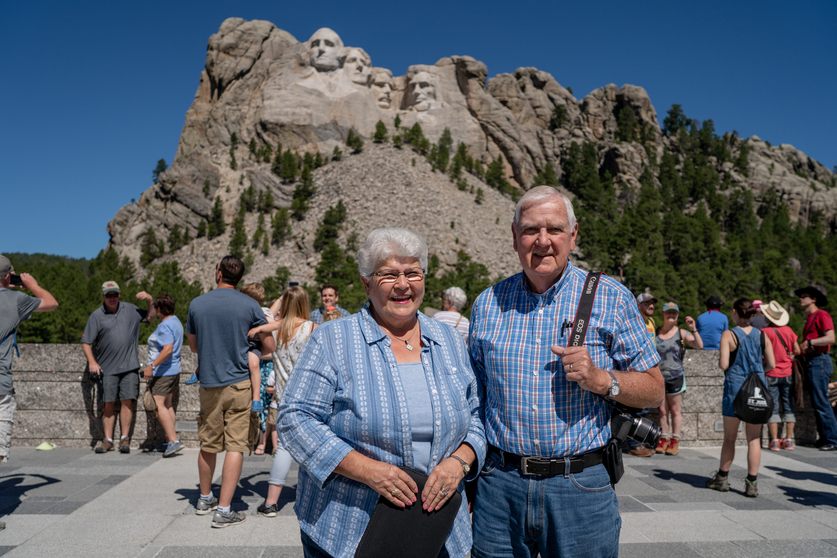 "Charles(right) and Gale Smith from Orlando, Florida, were inspired by Mount Rushmore. ""The Founding Fathers would be upset with the divides,"" Charles said. (Lenny Martinez Dominguez/News21)"