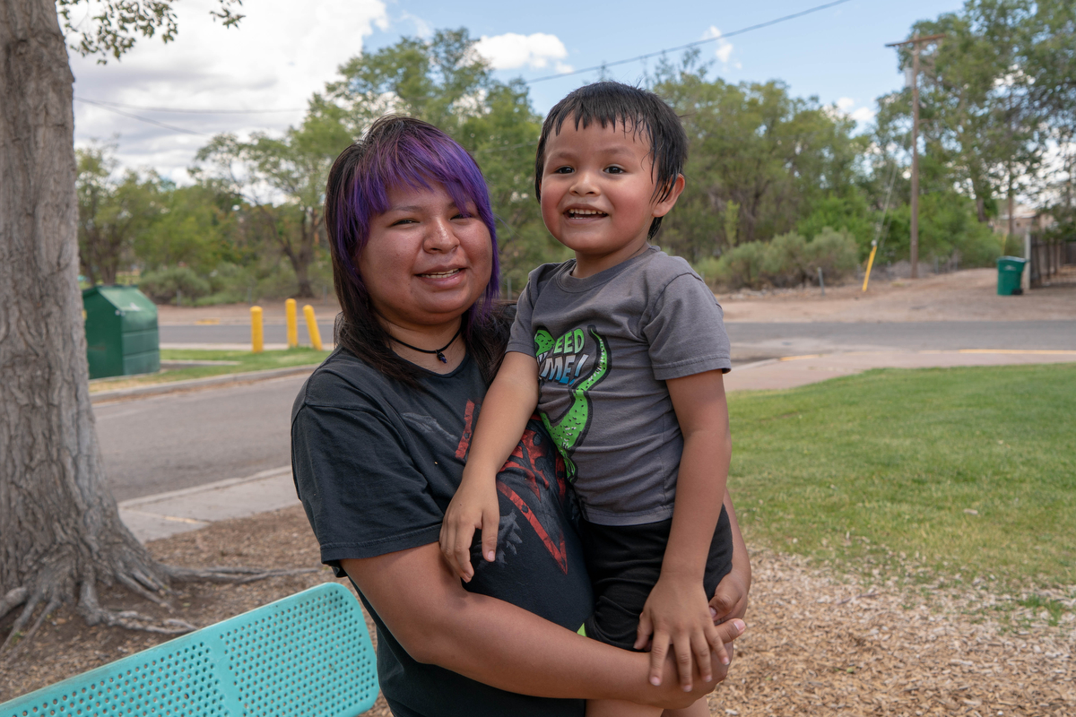 "Melanie Beyale, 23, of Grants, New Mexico, is fearful of the current state of the country. ""It's just crazy. That's why I hardly go out,"" she said. Her mother raised her as a member of the Navajo Indian Reservation, but Melanie has decided she is going to give her son, Jayden, a choice. ""If he wants to grow up Navajo, he can. I'm going to let him decide."" Melanie said that the way Native Americans are perceived is not an accurate reflection of their culture. ""Not all natives are drunks. Cause I think that's what they think,"" Melanie said. (Tilly Marlatt/News21)"