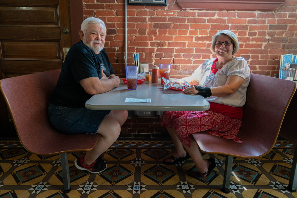 """We're the only Democrats in Arkansas,"" Reba Maynard said. Maynard is pictured with her husband, Larry, at Boomarang Diner in Van Buren, Arkansas. (Tilly Martlatt/News21)"