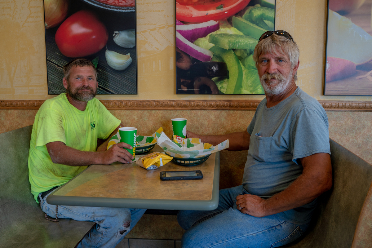 "Frankie McCandless (left) and Keith Terwillger are constructions workers from Tennessee working in Tekamah, Nebraska. ""Too many people are crying and moaning about every little thing,"" Terwilliger said. ""Everybody is just too tender. Everything upsets everybody."" (Lenny Martinez Dominguez/News21)"