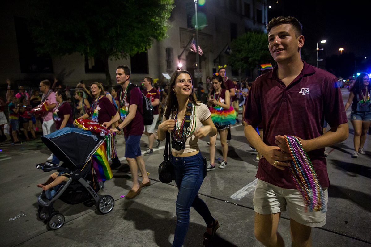 Brooks joined the university's group at the Houston Pride Parade this year as an alumnus.  After his election, he was targeted with threats of bodily harm and homophobic slurs.  (Shelby Knowles/News21)