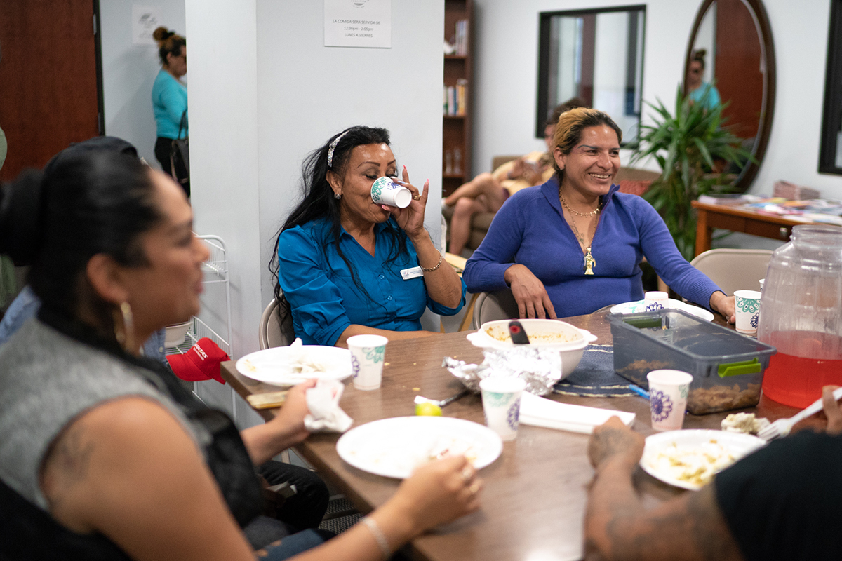 Clients of the TransLatin@ Coalition in Los Angeles eat lunch in the coalition's building. News21's investigation found that Latinos and LGBTQ people are hesitant to report hate crimes, in part because they mistrust police. (Angel Mendoza/News21)