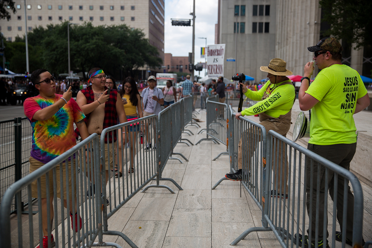 Participants and protesters photograph each other at the Houston Pride Parade in June. (Shelby Knowles/News21)