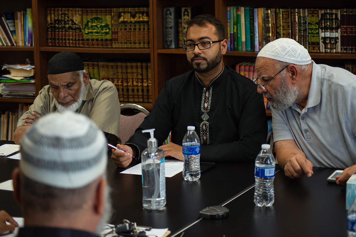 Faizan Syed (center), executive director of the Missouri chapter of the Council on American-Islamic Relations, discusses action plans with a local imam council. (Ashley Mackey/News21)