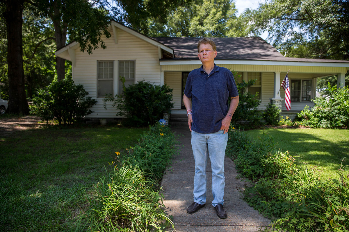 """House of horrors,"" Scott Shepherd murmured as he parkedin front of the small, white home where he grew up with four siblings, his mother and abusive father.  ""It was very violent. My dad would come home in drunken rages and take a butcher knife and cut mattresses up ... there wouldn't be any furniture staying in upright."" Seeking the love and support he didn't get from his own father, Shepherd said, he would have joined any group, even ISIS. (Shelby Knowles/News21)"